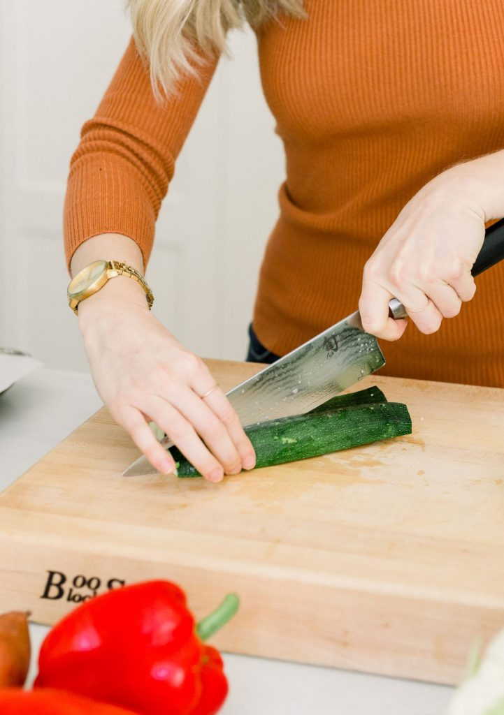 cutting zucchini during private cooking lessons winter park florida